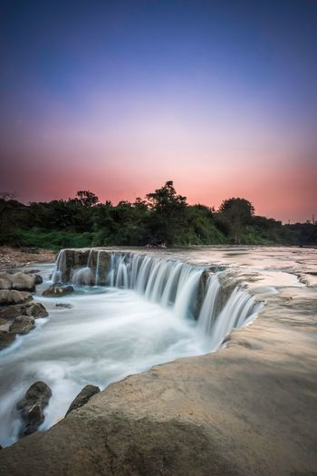 Motion Waterfall Long Exposure Scenics Beauty In Nature Tree Nature Water No People Clear Sky Outdoors Sky Travel Destinations Power In Nature Day