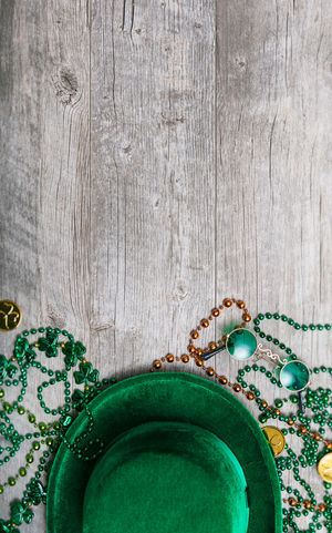 St. Patrick's Day series with lots of copyspace around beads, green beer and pots of gold. Green Hat Holiday Saint Patrick's Day Shamrock St. Patrick's Day St. Patricks Day St. Pattys Day Wood Background Irish No People Poster Background