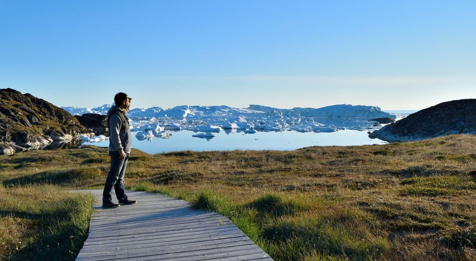 Photo taken by Ilulissat Icefiord, Greenland, at a Unesco world heritage site. A place of icebergs and serenity, home of the Inuit people. Adventure Arctic Arctic Circle Beauty In Nature Blue Sky Clear Sky Discovery Exploration Greenland Greenland,ilulissat Hiking Ice Icebergs Landscape Nature One Person Outdoors Sea And Sky Sky Summer Tranquil Scene Unesco UNESCO World Heritage Site Unescoworldheritage Vacations Lost In The Landscape