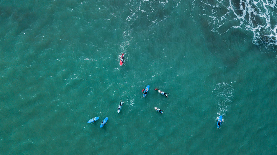 Group of surfers waiting to surf a wave