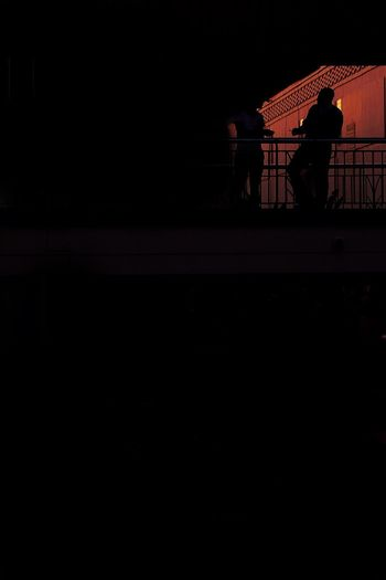 Talk Silhouette Real People Railing Lifestyles Dark Night People Standing Outdoors Unrecognizable Person The Street Photographer - 2018 EyeEm Awards HUAWEI Photo Award: After Dark