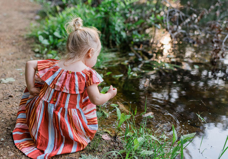 Full length of girl with plants in water