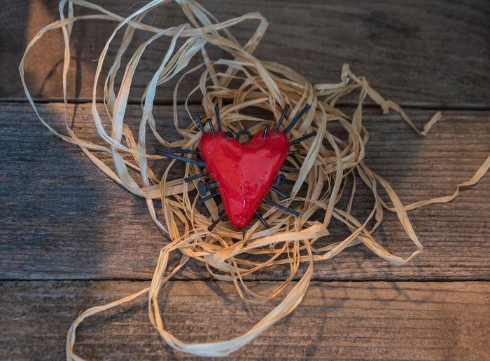Nurture a broken heart Day Healing Healthy Heart Heart Broken Heart Shape Hurting Love Loving No People Nurture  Red Romance Stabbed Stabbed In The Heart Wood