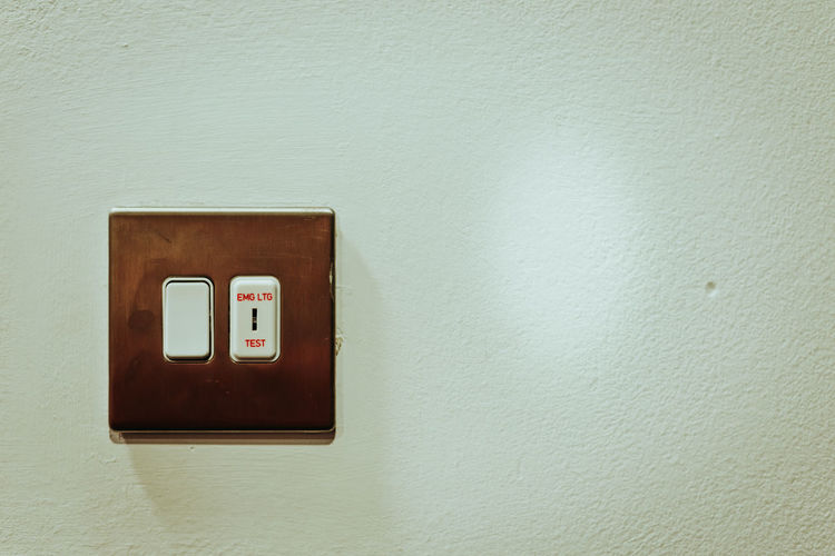 Light switch Lighting Equipment Abstract Architecture Built Structure Close Up Close-up Connection Copper  Day Electricity  Indoors  Interior Interior Design Light Switch No People Switch Wall - Building Feature Words