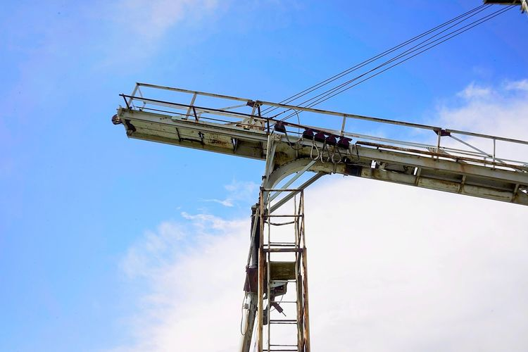 Conveyor  Sky Low Angle View Construction Industry Crane - Construction Machinery Industry Construction Site Machinery Development Cloud - Sky Nature Day Architecture Metal Built Structure No People Construction Machinery Outdoors Blue Construction Equipment