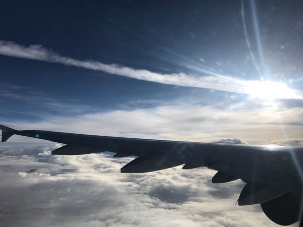 Airplane Sky Cloud - Sky Air Vehicle Flying Transportation Outdoors Day Aircraft Wing No People Airplane Wing Sunlight Nature