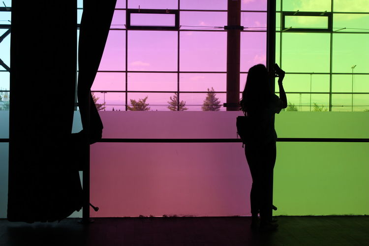 Ways Of Seeing Green Pink Multipurpose Building Human Figure Modern Architecture Architecture Photography Architecture EyeEm Selects EyeEmNewHere Window Silhouette Building Frosted Glass Outline The Traveler - 2018 EyeEm Awards The Architect - 2018 EyeEm Awards The Street Photographer - 2018 EyeEm Awards HUAWEI Photo Award: After Dark