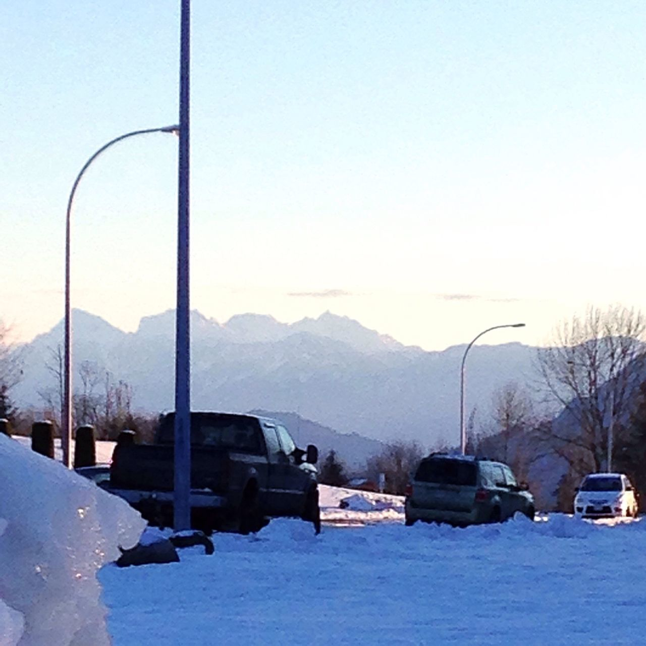 snow, cold temperature, winter, mountain, transportation, car, nature, outdoors, beauty in nature, day, land vehicle, scenics, mountain range, clear sky, tranquility, no people, sky, landscape, tree