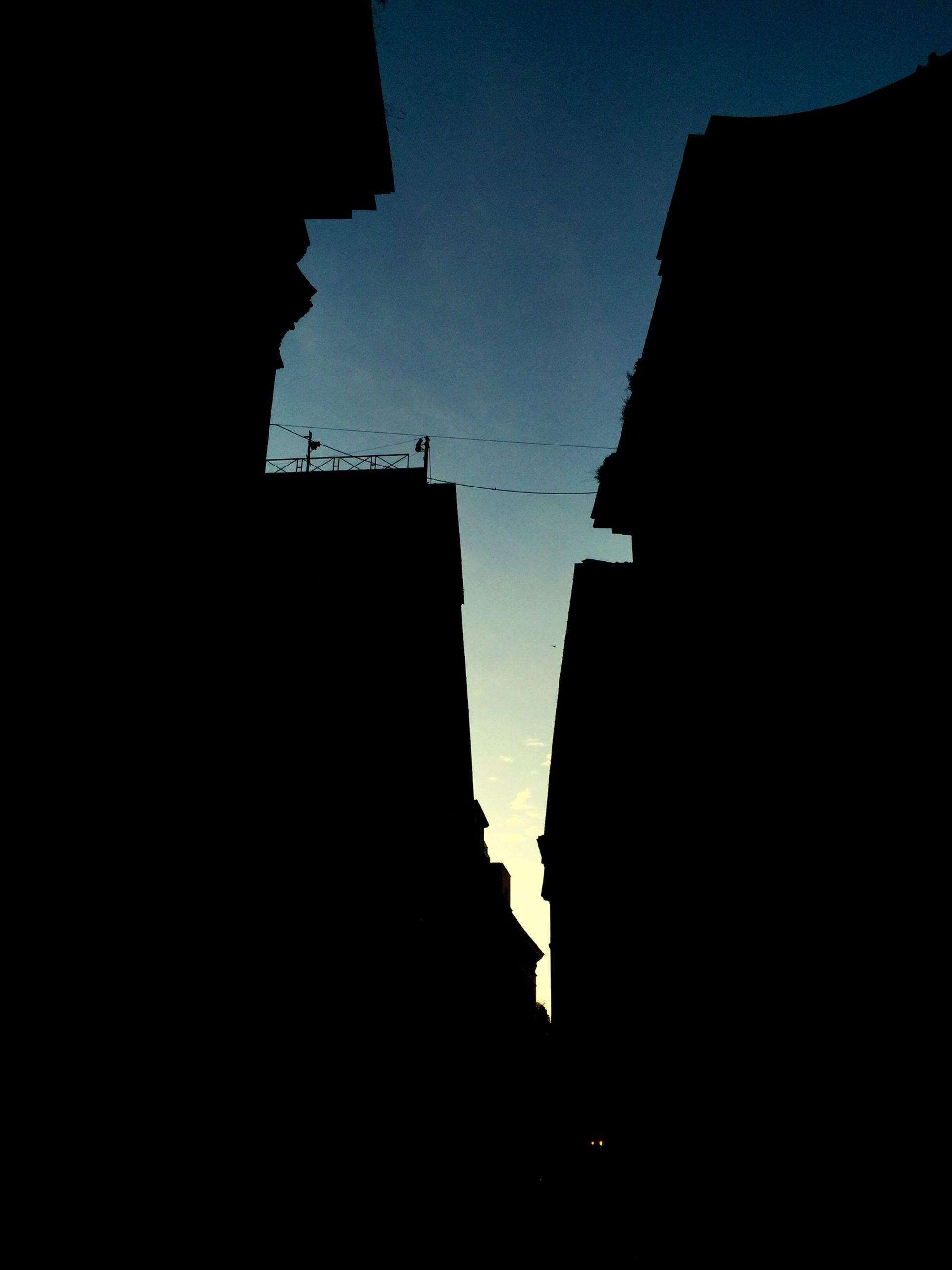 building exterior, architecture, built structure, silhouette, low angle view, sky, building, city, dusk, clear sky, tower, history, outline, outdoors, copy space, no people, residential building, travel destinations, residential structure, dark