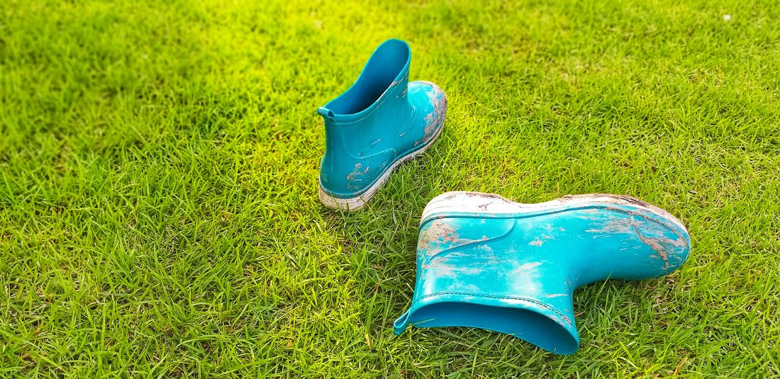 The view of the mud boots. Absence Blue Close-up Compatibility Day Field Grass Green Color Growth High Angle View Land Nature No People Outdoors Pair Personal Accessory Plant Representation Sandal Shoe Still Life Toy