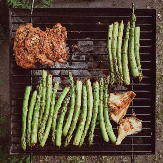 High angle view of soy meat and vegetables on barbecue grill