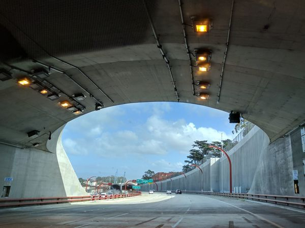 Emerging from underground cement tunnel in San Francisco,California on a sunny day Man-made Structure Cement Tunnels Highway Arched Architecture Cloud - Sky Sky No People Innovation Day Outdoors Architecture Tunnel Tunnel View Road City Built Structure Illuminated The City Light Light At The End Of The Tunnel Diminishing Perspective Empty Road Underpass
