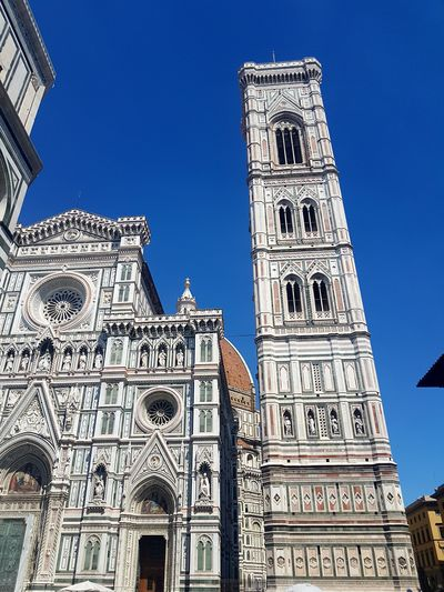 Duomo and Campanile - Firenze Low Angle View Architecture History Built Structure Religion Sunlight Bluesky no Clouds City Summer Atmosphere From My Point Of View Relaxing Moments Summertime Getting Creative Live For The Story Getting Inspired Lights And Shadows Outdoors Façade Travel Destinations Architecture Building Exterior