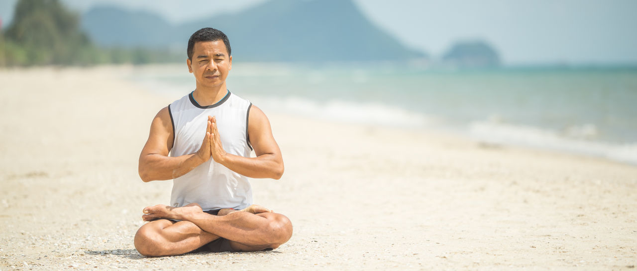 Beach Cross-legged Day Exercising Happiness Healthy Lifestyle Lifestyles Lotus Position Mature Adult Meditating Men Nature One Man Only One Person Outdoors Real People Relaxation Relaxation Exercise Sand Sitting Smiling Sports Clothing Wellbeing Yoga Zen-like