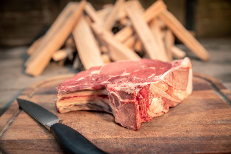 Close-up of meat on cutting board