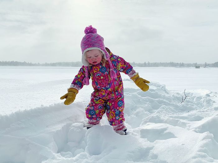 Girl in snow on field during winter