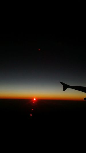 Sunrise From An Airplane Window Traveling This View
