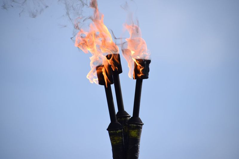 EyeEm Selects Flame Burning Heat - Temperature No People Low Angle View Outdoors Clear Sky Close-up Day Sky Fire Sticks Juggling Fire