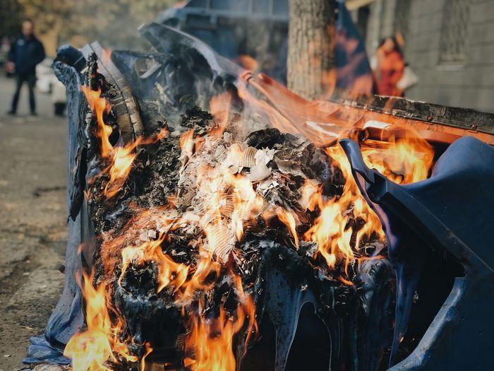 Close-up of burning vehicle on road