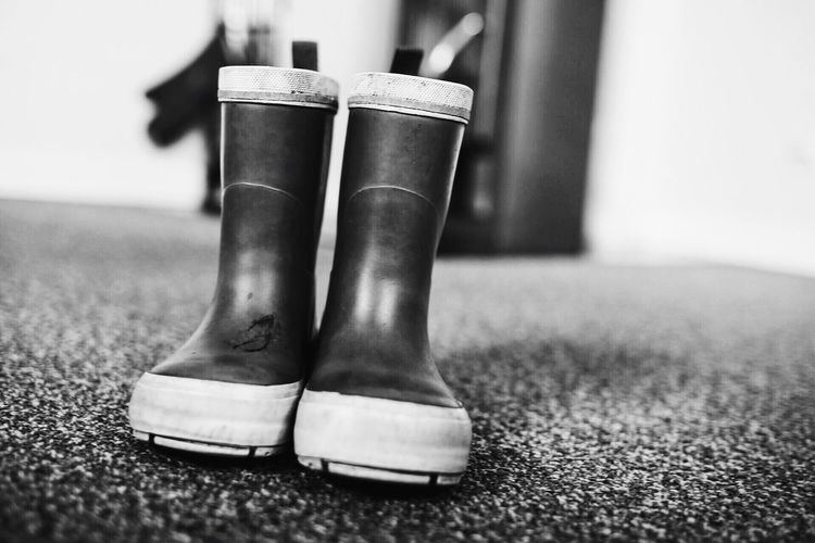 Boots Rainy Days Rubber Boots Rubber Black And White Photography Black & White Small Shoes Ground Ground Level View Clothing Protection Footwear Footwears Monochrome Monochromatic Getting Ready Getting Ready For School Two Is Better Than One