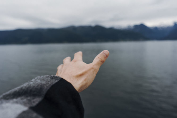 Close-up of hand in lake