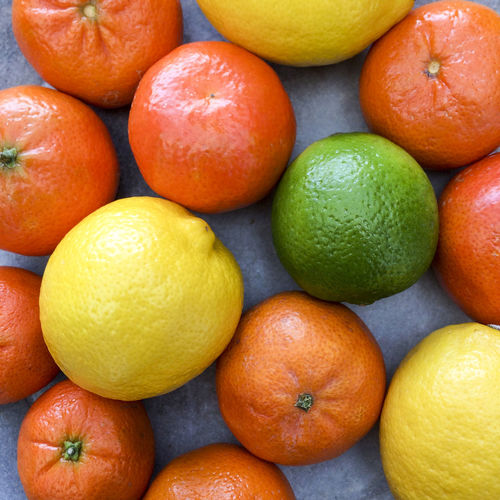 Directly above shot of various citrus fruits on table