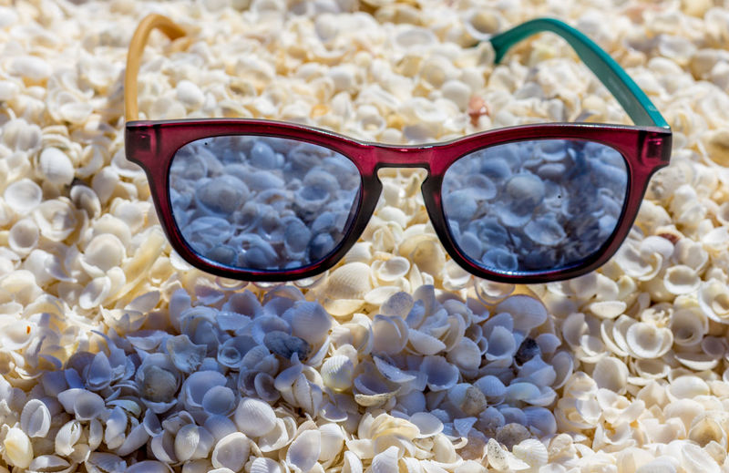 High angle view of sunglasses on glass