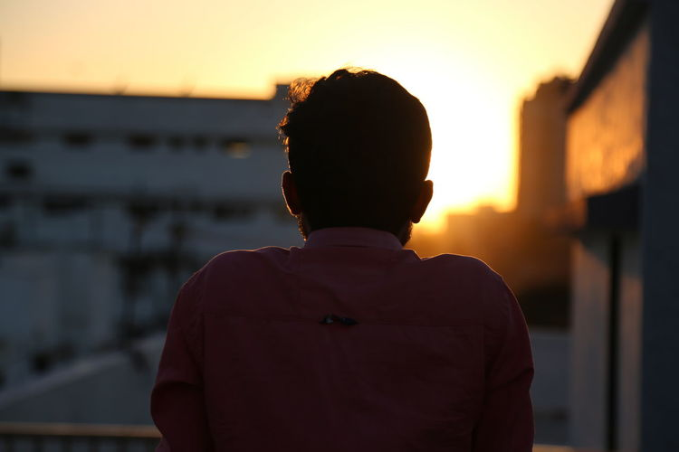 Sunset One Person Sky Real People Men Focus On Foreground Architecture Orange Color Rear View Lifestyles Standing Built Structure Building Exterior Nature Leisure Activity Outdoors Portrait Silhouette Waist Up The Art Of Street Photography Exploring Fun My Best Photo