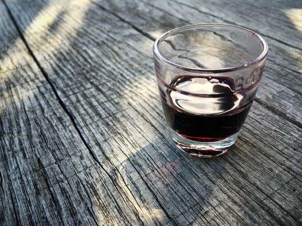 Yummy Liqueur Liquor Elderberry Elderberryliqueur Alcohol Drink Glass just 2cl... ;) Food And Drink Foodporn Wooden Table Close-up Half-full Light And Shadow Enjoying Life at a Kräutergarten  = Herb Garden