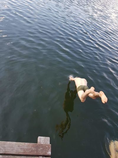 into the water Lake Water Swimming Human Hand Diving Into Water Diving Swimming Trunks