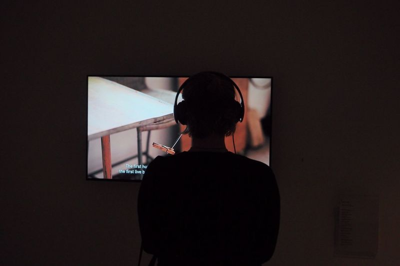 Headphones Rear View One Person Indoors  Arts Culture And Entertainment Standing Leisure Activity Screen Device Screen Technology