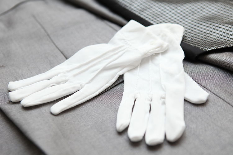 The groom's glove on the bed Clothing Textile Selective Focus Close-up Still Life No People White Color Fashion Wedding Gloves Glove Gloved Hand