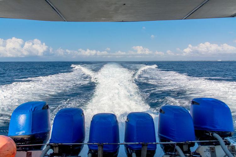 Speedboat moving in sea against sky
