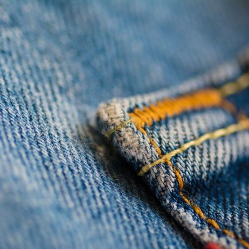 Close-up Selective Focus Yellow Blue Textile Extreme Close-up Full Frame No People Man Made Object Blue Jeans Close-up Country Western Style Denim