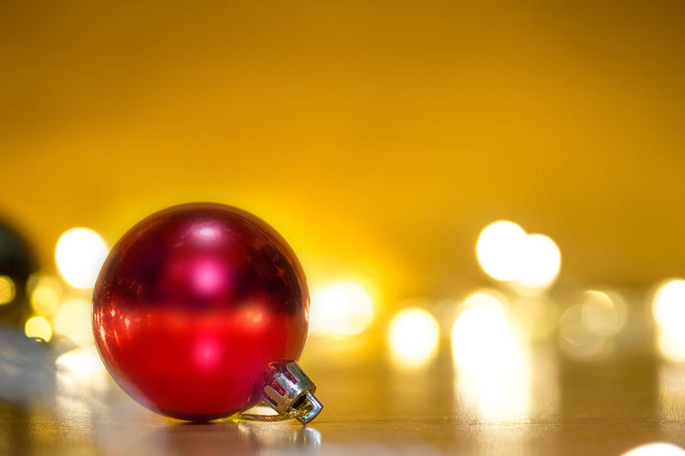 Close-Up Of Christmas Bauble On Table