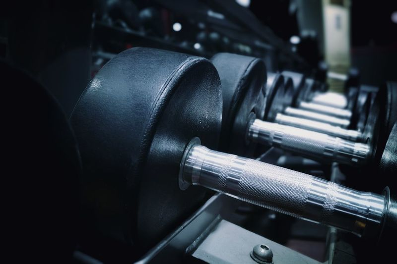Day 7 Manufacturing Equipment Industry Gym Factory Dumbbell Black Color Business Finance And Industry Close-up Weightlifting Human Muscle Abdominal Muscle Strength Training Weight Training  Weights Body Building Exercise Equipment Barbell Flexing Muscles Muscular Build Push-ups Health Club Bicep Cross Training