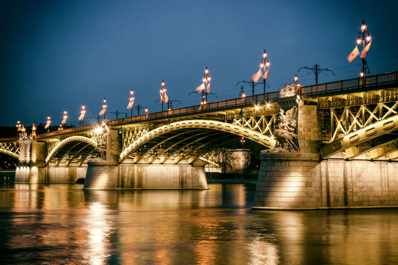 Illuminated Margaret Bridge Over River Against Sky At Dusk