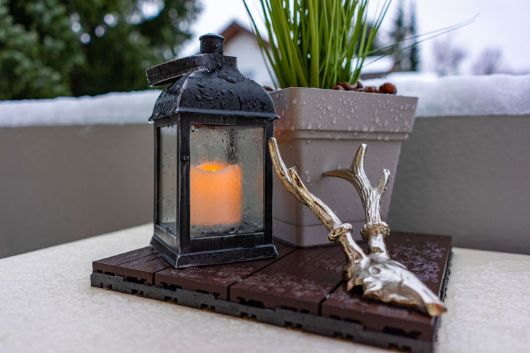 A candle on the taple Candle No People Flame Burning Fire - Natural Phenomenon Fire Table Heat - Temperature Close-up Nature Day Glass - Material Focus On Foreground Indoors  Metal Transparent Container Lighting Equipment Decoration Still Life Tea Light Electric Lamp