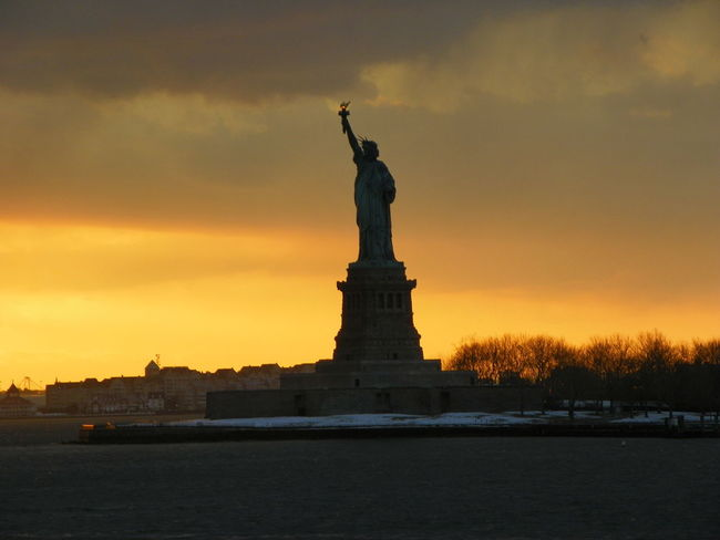 Beauty In Nature Cloud - Sky Female Likeness New York City New York Harbor New York, New York No People Outdoors Sky Statue Statute Of Liberty Sunset Travel Destinations Water