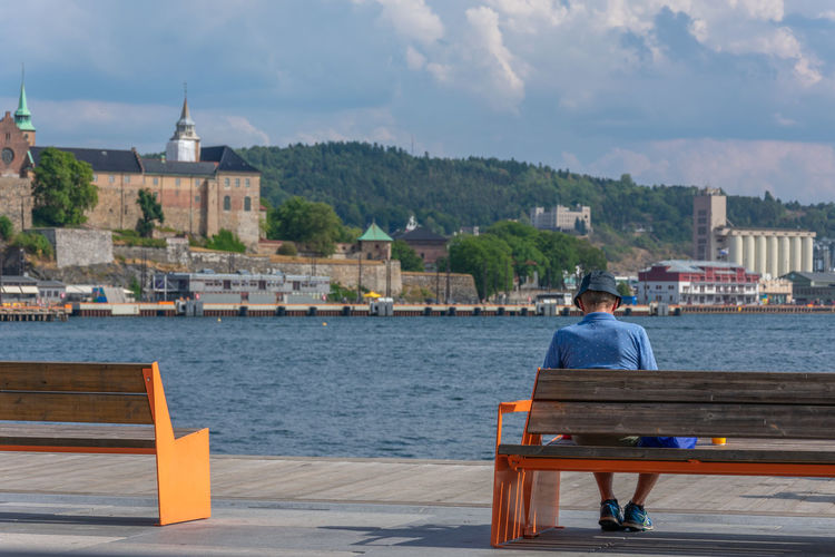 Man on bench in Oslo, Norway Bench Harbor Harbour Man Norway Oslo Oslo, Norway View Built Structure Day Lifestyles Man On Bench Men One Person Outdoors Real People Seat Sitting Sky South Norway Water