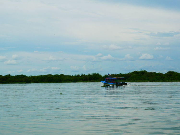 ASIA Cambodia South East Asia Travel Beauty In Nature Boat Cloud - Sky Day Mode Of Transport Nature Nautical Vessel No People Outdoors River Sailing Scenics Siemreap Sky Tonle Sap Lake Tonlesap Transportation Water Waterfront Perspectives On Nature