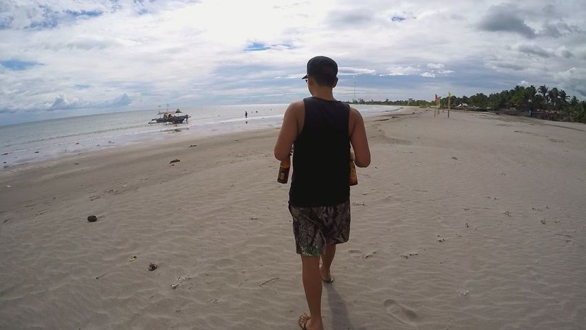 Beach Sand One Man Only Sea Cloud - Sky One Person Only Men Full Length Standing Adult Landscape Outdoors Vacations Sky Day Water Summer Beer Bottle Drink Alcohol San Miguel Red Horse Beer Red Horse Philippines