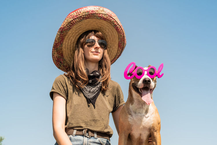 Funny Mexico Sunny Canine Clear Sky Clothing Dog Domestic Domestic Animals Front View Hairstyle Hat Mammal Mexican Nature One Animal One Person Pet Owner Pets Portrait Real People Sky Sombrero Sun Hat Women