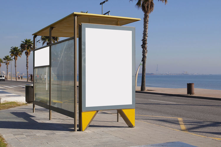 Blank billboard in a bus stop, for advertisement Ad Advertisement Advertisement Posters Advertising Banner Billboard Blank Bus Bus Stop Commercial Marketing Mock Up Palm Palm Tree Poster Promo Promotion Road Sea Shelter Street Urban