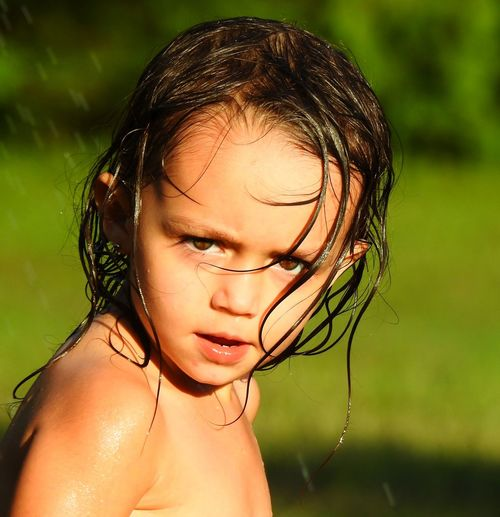 Close-up portrait of shirtless girl