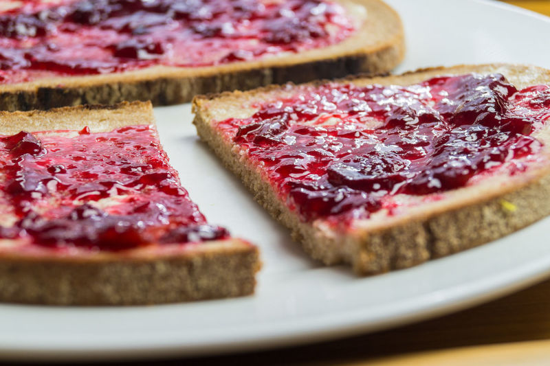 Close-up of breads with strawberry jam in plate
