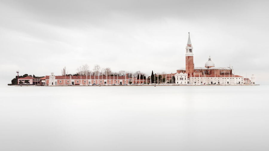 view at San Giorgio Maggiore in Venice against clear sky Architecture Church Fine Art Photograhy San Giorgio Maggiore Island Venice, Italy Architecture Building Building Exterior Built Structure Canal City Cloud - Sky Copy Space Day Fine Art Island Italy Long Exposure Nature No People Philipp Dase Place Of Worship Religion San Giorgio Maggiore Sky Spire  Spirituality Tower Travel Destinations Venice Venice View Water Waterfront The Traveler - 2018 EyeEm Awards My Best Travel Photo