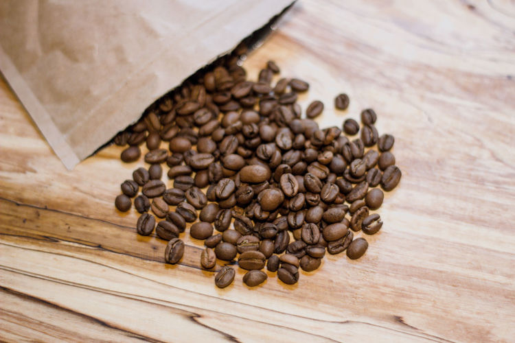 Coffee Food And Drink Coffee - Drink Brown Roasted Coffee Bean Freshness Food Large Group Of Objects Close-up No People Roasted Wood - Material High Angle View Table Indoors  Still Life Caffeine Abundance Drink Spilling