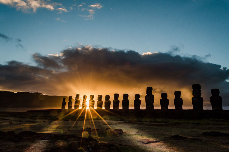 Ahu Tongariki Sunrise Easter Island (Rapa Nui) is one of the most remote and mysterious destinations on the planet with a unique images are captured over the course of a day, with sunrise at Ahu Tongariki, afternoon vista from Rano Raraku and sunset at Ahu Tahai. Easter Island Isla De Pascua Moai Rapa Nui Ahu Cloud - Sky Nature Silhouette Sky Sun Sunlight Sunrise The Traveler - 2018 EyeEm Awards
