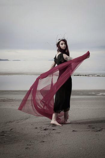 A life spent uneasy. Utah The Great Salt Lake Great Salt Lake Water Sea Beauty Full Length Women Beach Beautiful Woman Fashion Model Sand Red Symbolism